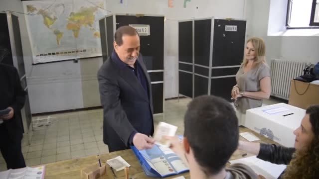 former italian prime minister silvio berlusconi casts his ballot at a polling station during the local elections in rome italy on june 5 2016 local... - 2016 stock-videos und b-roll-filmmaterial