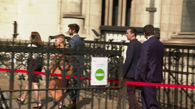 former labour party employees leave royal courts of justice after being awarded damages and an apology from the labour party over how their anti... - royal courts of justice stock videos & royalty-free footage