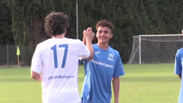 Former Lazio and AS Roma football stars clinch a 41 victory over a team of migrants in a match to raise public awareness of the plight of refugees in...