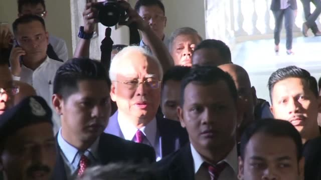 vídeos de stock, filmes e b-roll de former malaysian prime minister najib razak arrives in court before being charged with corruption in a stunning fall from grace for a national leader - ex