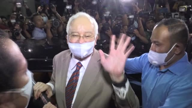 former malaysian prime minister najib razak proclaims his innocence to supporters outside a kuala lumpur court on tuesday night after being sentenced... - former stock videos & royalty-free footage