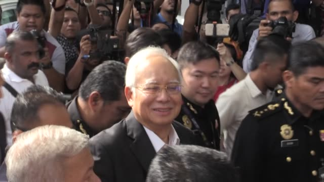 former malaysian prime minister najib razak was sentenced to 12 years in jail on tuesday after being found guilty in his first trial over the... - former stock videos & royalty-free footage