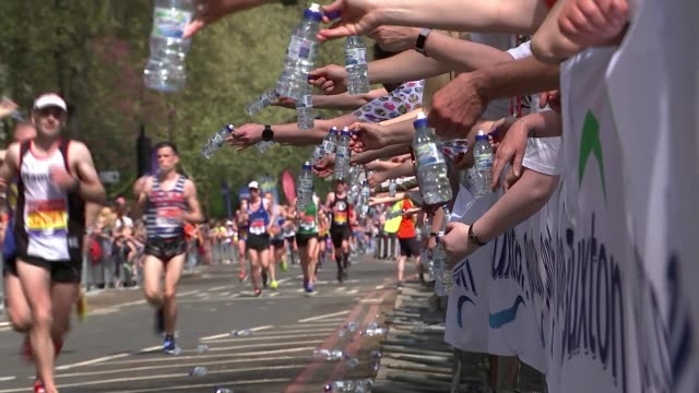 former masterchef contestast dies during the london marathon t220418004 / london ext spectators holding out bottled water as runners along - london marathon stock videos & royalty-free footage
