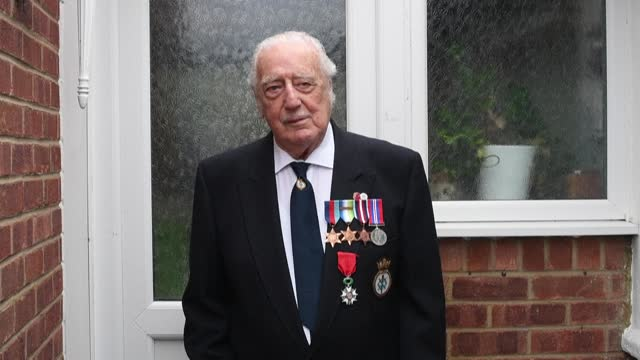 former member of britain's royal navy, ray smith, stands outside his home in northampton, central england to observe two minutes of silence on... - northampton england stock videos & royalty-free footage