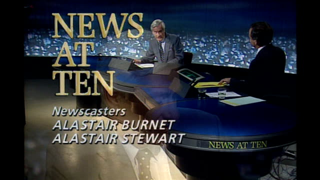 former news at ten presenter sir alastair burnet dies; 1980s alastair burnet and alastair stewart in news at ten studio - alastair burnet stock videos & royalty-free footage