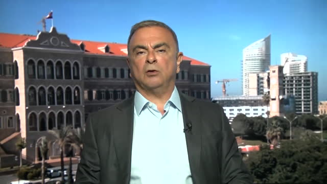 """former nissan ceo carlos ghosn saying hiding in a box whilst waiting for the plane to take off to escape japan was """"the longest wait in my life"""" - """"bbc news"""" stock videos & royalty-free footage"""