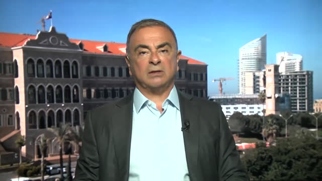 """former nissan ceo carlos ghosn saying when he hid in a box to escape japan """"i just thought about the moment"""" - """"bbc news"""" stock videos & royalty-free footage"""