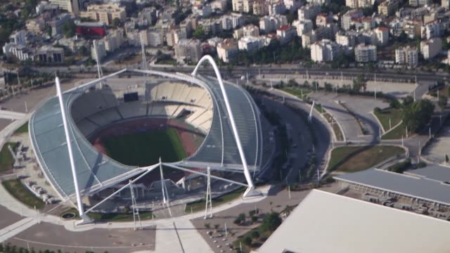 stockvideo's en b-roll-footage met former olympic stadiums and sports arenas sit on the abandoned 2004 olympic site in the hellenikon district of athens greece on thursday june 25 2015 - athene griekenland