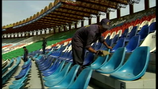 former pakistani cricket captain denies match fixing at world cup lahore general view of cricket ground with cleaners cleaning stadium seats illegal... - pakistani flag stock videos and b-roll footage