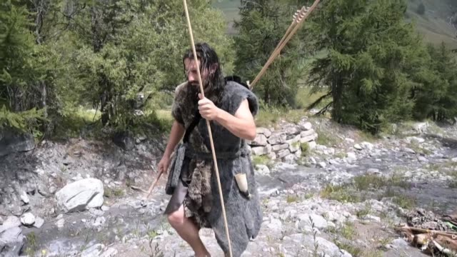 stockvideo's en b-roll-footage met former pastry chef guido camia is now making a living offering neanderthal survival courses in the italian alps - prehistorische mens