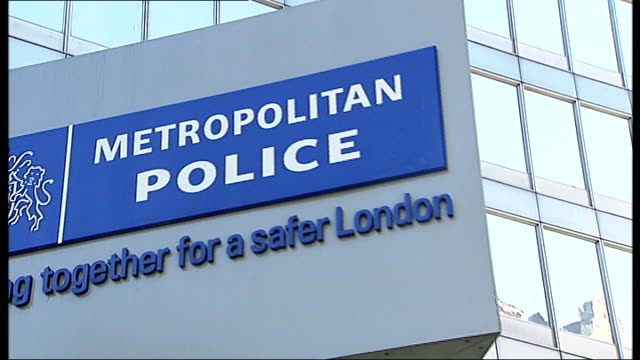 former police commander ali dizaei found guilty of corruption for a second time t30091141 / tx various of rotating 'new scotland yard' sign ali... - ニュースコットランドヤード点の映像素材/bロール