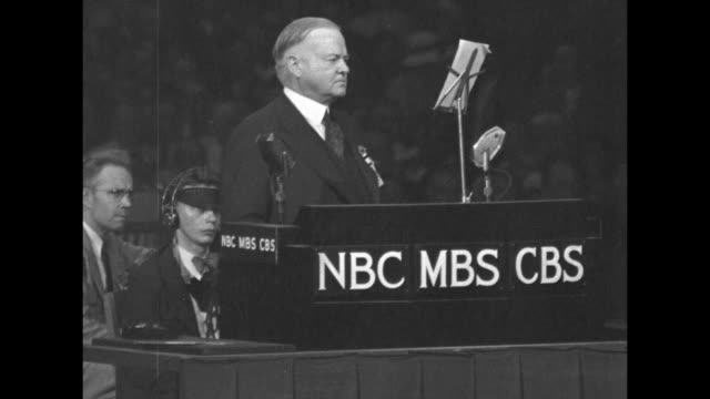 former pres herbert hoover standing at podium of cleveland public auditorium speaking to convention / delegates standing and cheering / hoover... - herbert hoover us president stock videos & royalty-free footage