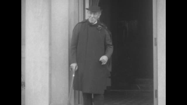 vs former pres woodrow wilson wearing top hat cape and overcoat with boutonniere smiles as he stands at the doorway of his washington dc home he... - top hat stock videos & royalty-free footage