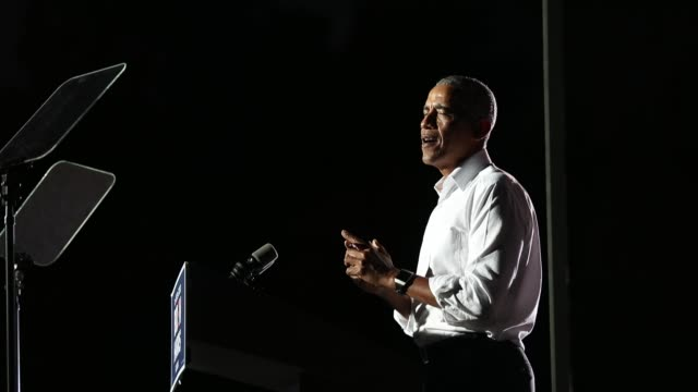 former president barack obama speaks in support of democratic presidential nominee joe biden during a drive-in rally at the florida international... - バラク・オバマ点の映像素材/bロール