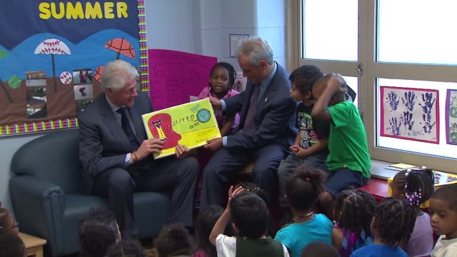 former president bill clinton made a cameo at the metropolitan family services learning and wellness center with mayor rahm emanuel in chicago on... - cameo brooch stock videos & royalty-free footage