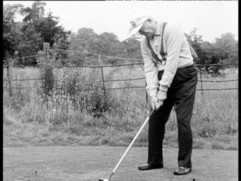 former president dwight d eisenhower swings and hits golf ball on golf course surrey 13 aug 62 - golf swing stock videos & royalty-free footage