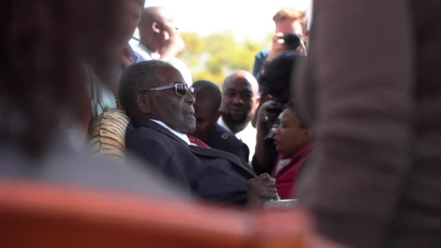 Former President of Zimbabwe Robert Mugabe and wife Grace sitting down to speak to reporters in Harare