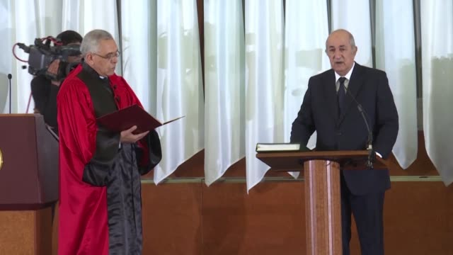 former prime minister abdelmadjid tebboune swears in as the new president of protest hit algeria a week after winning a widely boycotted election - president stock videos & royalty-free footage