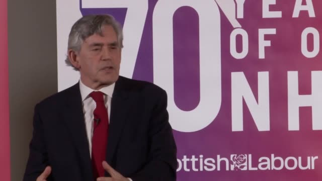 former prime minister gordon brown makes a speech about the nhs in glasgow to marks its 70th anniversary he calls for new political leadership - ゴードン ブラウン点の映像素材/bロール