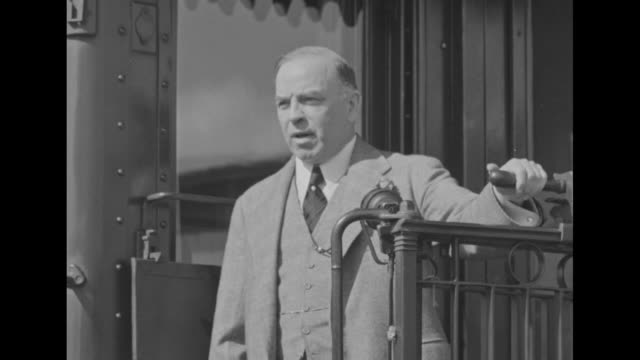 Former prime minister Opposition Leader Mackenzie King stands at rear of passenger train car / SOT on itinerary portion of stump speech