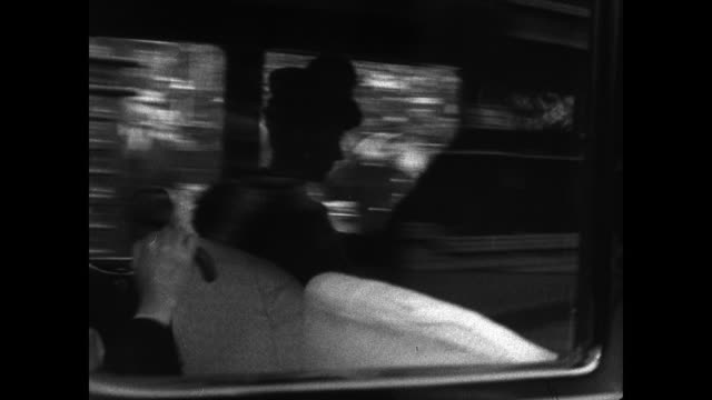 vídeos y material grabado en eventos de stock de former queen mary of teck in back seat of car. vs london street english man pushing cart chauffeur sitting on back bumper reading newspaper people... - 1930 1939