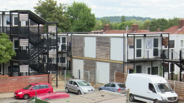 former shipping containers being used as homes to accomodate the homeless london - cargo container stock videos & royalty-free footage