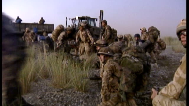 former soldier avoids jail for road rage attack r21090601 helmand province ext british troops firing weapons in open scrub area during gun battle - 脱獄する点の映像素材/bロール