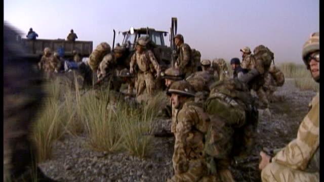 former soldier avoids jail for road rage attack r21090601 helmand province ext british troops firing weapons in open scrub area during gun battle - gefängnisausbruch stock-videos und b-roll-filmmaterial