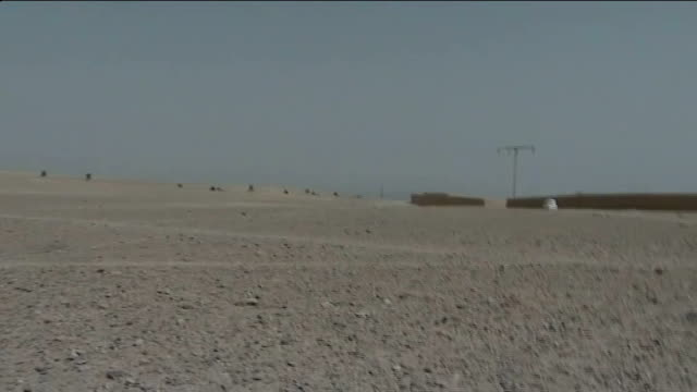 former soldier avoids jail for road rage attack t07071006 helmand province ext british troops firing weapons in desert area during gun battle... - 脱獄する点の映像素材/bロール
