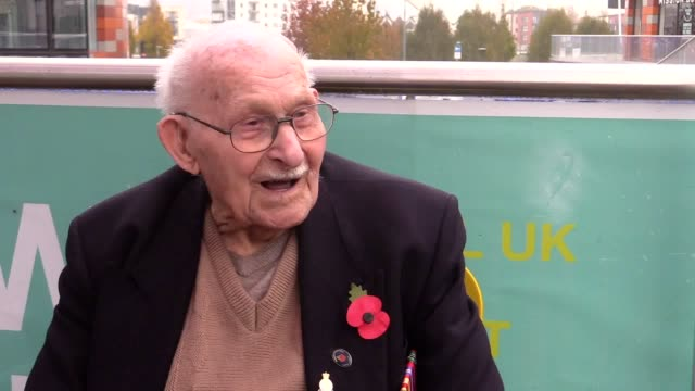 former soldier who survived the auschwitz concentration camp is selling poppies for the royal british legion, aged 100. interview with ron jones,... - mid wales stock videos & royalty-free footage