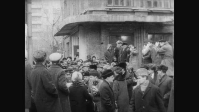 Former Soviet Premier Nikita Khrushchev walking on the streets of Moscow surrounded by a huge crowd of onlookers and press / Khrushchev nods and...