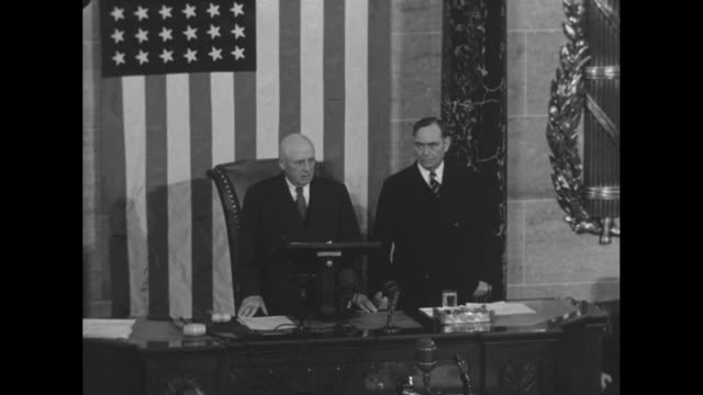 former speaker of the us house of representatives sam rayburn at left stands with new speaker joseph martin jr at the speaker's dais rayburn... - sam rayburn video stock e b–roll
