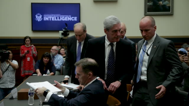 Former Special Counsel Robert Mueller leaves after he testifed before the House Intelligence Committee about his report on Russian interference in...