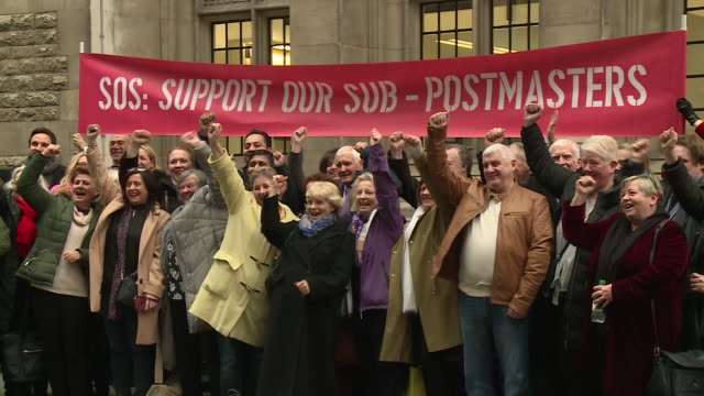 former subpostmasters accused of stealing from the post office celebrating after a high court ruling that found fault with the computer system - purity stock videos & royalty-free footage