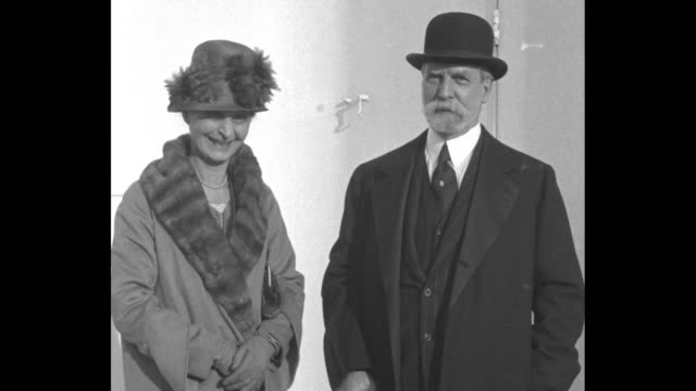 former supreme court associate justice and secretary of state charles evans hughes standing next to wife antoinette posing for photo opportunity upon... - the hague 個影片檔及 b 捲影像