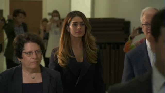 former trump campaign communications person and advisor to the president hope hicks walks in a hallway to the house judiciary committee room for a... - präsident der usa stock-videos und b-roll-filmmaterial