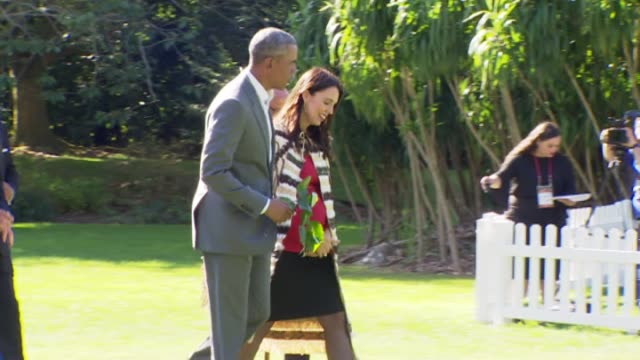 former united states president barack obama and new zealand prime minister jacinda ardern walk together after maori welcome - minister president stock videos and b-roll footage