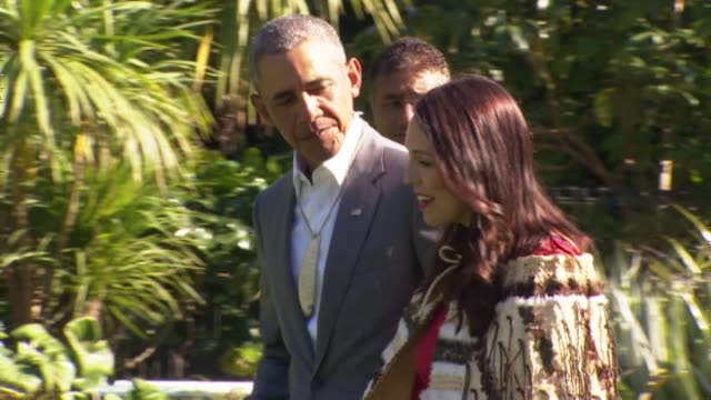 former united states president barack obama walking with new zealand prime minister jacinda ardern after receiving a maori welcome at government house - minister president stock videos and b-roll footage