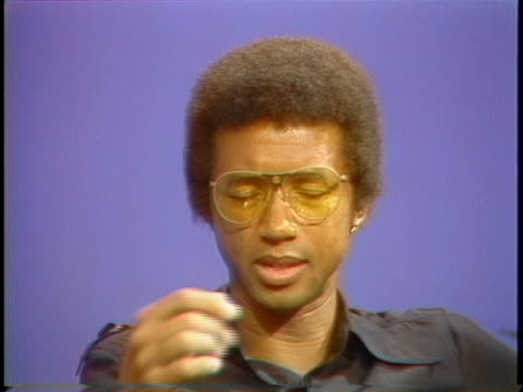 vídeos de stock e filmes b-roll de former u.s. open champion arthur ashe comments on the performance of one of the eastern european tennis players. - eastern european culture