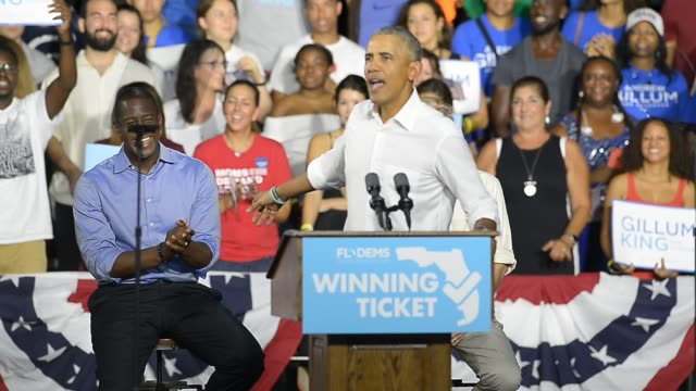 former u.s. president barack obama, center, speaks as andrew gillum, democratic candidate for governor of florida, left, and senator bill nelson, a... - former stock videos & royalty-free footage