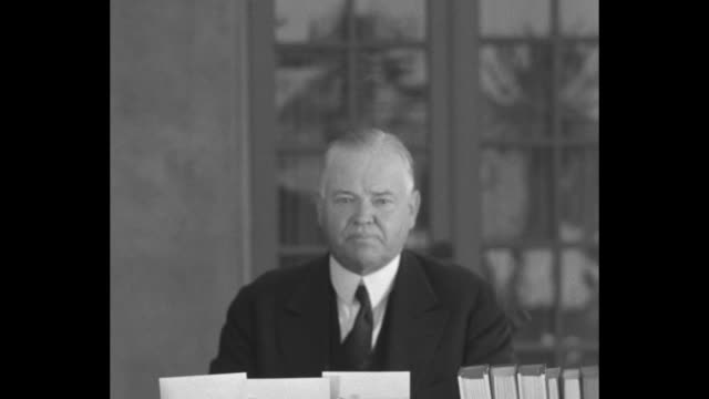 former us president herbert hoover sits at table covered with books on the patio of his home in palo alto ca sot hoover reads statement we are told... - herbert hoover us president stock videos & royalty-free footage