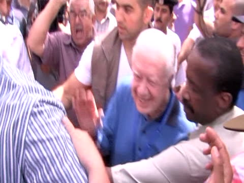 former us president jimmy carter arrives in egypt as part of delegation of election observers - jimmy carter präsident stock-videos und b-roll-filmmaterial