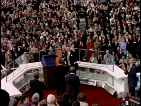 vídeos de stock, filmes e b-roll de former us president jimmy carter shakes hands with us president ronald reagan and his wife nancy after reagan's inauguration on january 20 1981 - tomada de posse