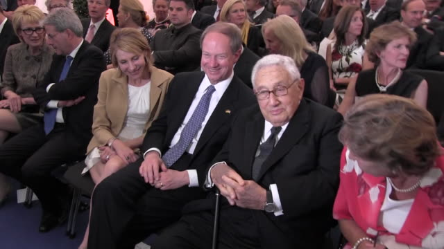 Former US Secretary of State Henry Kissinger seen seated next to US Ambassador to Germany John B Emerson and his wife Kimberly Emerson during the...