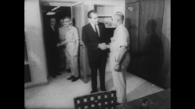 former vice president richard nixon shakes hands with israeli defense minister moshe dayan / press watch as the two men talk in tel aviv, israel - 1967 stock videos & royalty-free footage