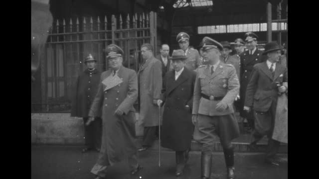 former vichy chief of government minister of foreign affairs interior information propaganda pierre laval exits building escorted by german army... - 大臣点の映像素材/bロール