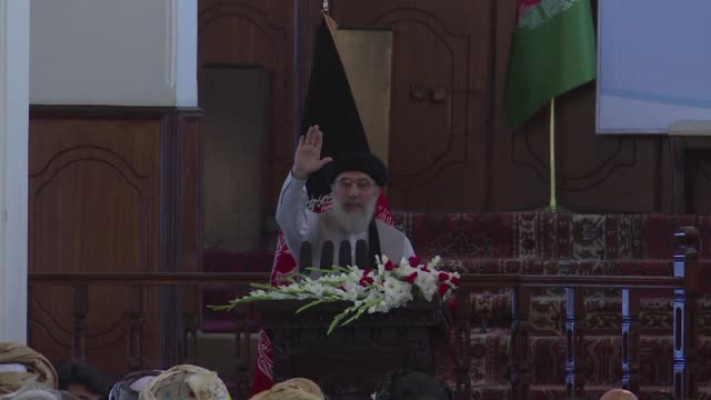 former warlord branded the butcher of kabul made a triumphant return to the afghan capital thursday met by uneasy residents two decades after leaving... - früherer stock-videos und b-roll-filmmaterial