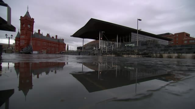 Former Welsh government minister Carl Sargeant found dead at his home WALES Cardiff EXT GVs Welsh Assembly on dark rainy day Flags lowered outside