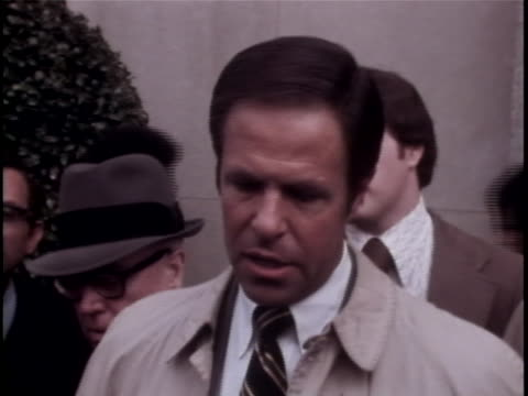 "former white house chief of staff, harry robbins ""bob"" haldeman, makes a comment to the press. haldeman was a suspect in the watergate scandal. the... - リチャード・ニクソンの大統領辞任点の映像素材/bロール"