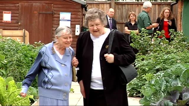 former women's land army members visit replica allotment in st james' park with hilary benn more of former land girls walking round allotment... - gemeinschaftsgarten stock-videos und b-roll-filmmaterial